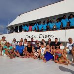 Carpe Diem crew with happy guests in the Maldives