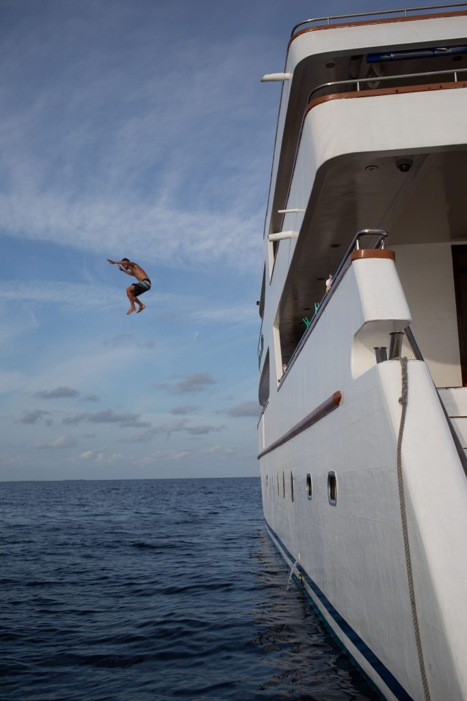 Jumping off the sundeck of the Carpe Vita Maldives having some fun